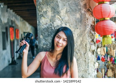 Bangkok Thailand JUNE 2 2019 , Beautiful asian girl with Gopro camera in hand portrait at Lhong 1919 Bangkok is a 19th century Chinese mansion that has been fully restored and opened as an attraction.