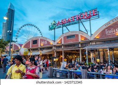 BANGKOK, THAILAND - JUNE 2, 2019 : Ferris wheel at Asiatique, The Riverfront is a large open-air mall in Bangkok. It occupies the former docks of the East Asiatic Company, faces the Chao Phraya River.