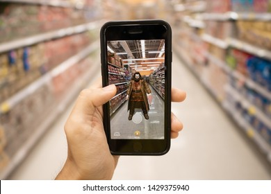Bangkok, Thailand - June 20, 2019 : iPhone 7 showing its screen with Harry Potter Wizards Unite application.