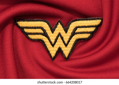 BANGKOK, THAILAND -JUNE 20: Wonder Woman Logo on Red Fabric on June 20,2017