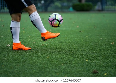 Bangkok / Thailand - June 2018 : Football player training on artificial grass field. Wearing Nike Mercurial Superfly VI, the famous football boots for speedy player like Cristiano Ronaldo and Neymar.