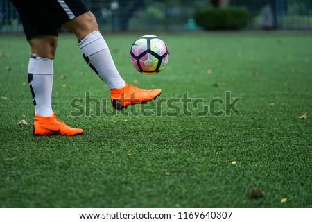 00b250ca58b Bangkok   Thailand - June 2018   Football player training on artificial grass  field. Wearing