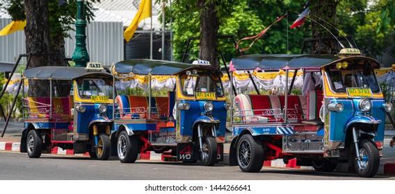 BANGKOK, THAILAND - June, 2019: Tuktuk in downtown Bangkok. Tuktuk is the Thai nickname given to an auto-rickshaw, a three-wheeled miniature truck.