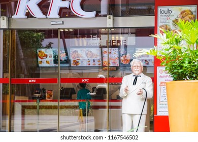 BANGKOK ,THAILAND- June 20,2017: Colonel Harland Sanders statue standing in front of Kentucky Fried chicken restaurant (KFC)