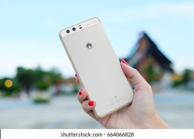 BANGKOK, THAILAND - JUNE 21: Huawei P10 Plus with Leica dual camera in gold color is holding in a hand on June 21, 2016 in Bangkok, Thailand