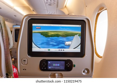 BANGKOK, THAILAND - JUNE 22, 2015: seat back screen in economy class on Emirates Airbus A380-800.