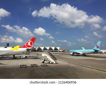 BANGKOK, THAILAND - JUNE 22, 2018: Cebu Pacific Airlines, Turkish Airlines, and Korean Air aircraft are preparing to take off at Suvarnabhumi International Airport.