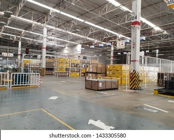 Bangkok, Thailand - June 22, 2019: Warehouse logistic or distribution center in electronic industry. Interior of warehouse with rows of shelves with big boxes.