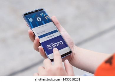 Bangkok / Thailand- June 22 2019: Libra logo on Facebook app on the smartphone screen. New global digital currency based on technology created by Facebook.