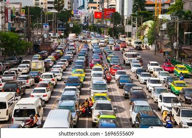 Bangkok, Thailand - June 22, 2019 : Congestion traffic in afternoon on Asoke junction at downtown of Bangkok, Thailand - Vintage filter