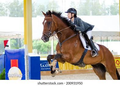 BANGKOK, THAILAND - JUNE 22: Unidentified Equestrian with horse at MaxWin Show Jumping League & Horse Guard 2014  on June 22, 2014 in Royal Horse Guard MaxWin Riding Arena Bangkok, Thailand.