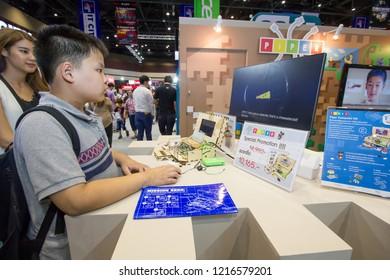 BANGKOK, THAILAND - June 24: Queen Sirikit National Convention Center on June 24,2018 in Bangkok, Thailand. Boy exciting to play Piper Raspberry Pi Computer Kit at Computer Exhibition