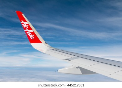 Bangkok, Thailand - June 25, 2016: Thai AirAsia plane's wing with logo, the plane flying from Bangkok to Suratthani Flight no. FD 3231. AirAsia as Asia's Leading Low Cost Airline.