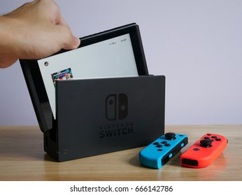 Bangkok, Thailand - June 25, 2017 : Nintendo Switch, the video game console on wooden table.