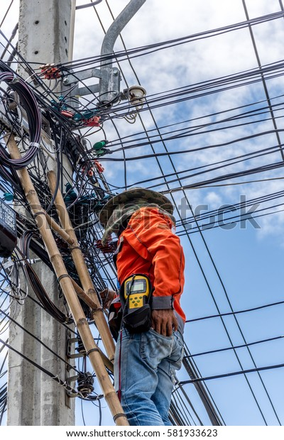 Bangkok, Thailand - June 26, 2016 : Unidentified worker working to install electric line by scaffolding on pickup truck at Bangkok Thailand.