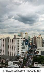BANGKOK, THAILAND - JUNE 26, 2017: Bangkok wholesale and retail hub Pratunam. Traffic jam and Cloudy sky. Petchaburi Road in cloudy day in Pratunam area.