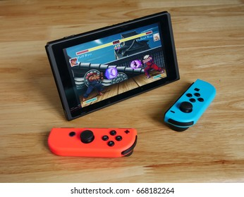 Bangkok, Thailand - June 27, 2017 : Nintendo Switch showing its screen with Ultra Street Fighter game.