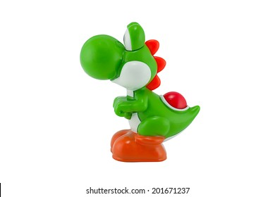 BANGKOK, THAILAND - June 28, 2014 : Yoshi dino character from Super Mario. There are toy sold as part of McDonald HappyMeal toy.