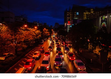 Bangkok, Thailand - June 28, 2015: Busy evening street in Bangkok downtown