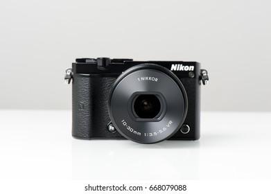 BANGKOK, THAILAND - JUNE 28, 2017: Black Nikon 1 J5 with 1 Nikkor 10-30mm attached. The Nikon 1 J5 is a digital mirrorless camera announced by Nikon on April 2, 2015.