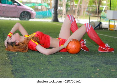 BANGKOK, THAILAND - JUNE 29, 2014: Unidentified model with Spain costume pose for promote World Cup 2014 in futsal park on June 29, 2014 in Bangkok, Thailand.