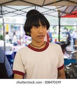 Bangkok, Thailand - June 29, 2015: Portrait of young man selling food in sidewalk in Bangkok street