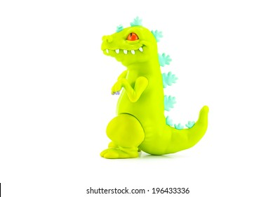BANGKOK, THAILAND - June 3, 2014 : Reptar toy figure is big green dinosaur reminiscent of Godzilla a character in Rugrats. There are toy sold as part of Burger King toy.