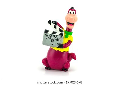 BANGKOK, THAILAND - June 3, 2014 : Dino character from The flintstones animated hold a clapper Board figure, There are figure model by Hanna Barbera inc.