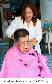 BANGKOK THAILAND - JUNE 3, 2016 : Woman barber haircut to The Old woman in Bangkok Thailand.