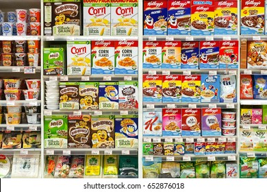 Bangkok, Thailand - June 3, 2017 : Cereal or cornflakes on shelf in Foodland supermarket. Various brands of cornflakes are on the display shelves including Kelloggs and Nestle. Editorial Used only.