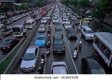 Bangkok, Thailand - June 3 2019: Traffic in the evening at Huai Khwang and Suthisan area in Ratchadaphisek road. Ratchadaphisek Road is a major rd in Bangkok, Thailand with heavy traffic in rush hour.