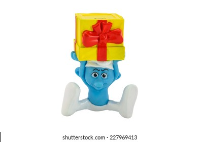 BANGKOK, THAILAND - June 30, 2014 : Smurf on a gift box character toy from The Smurf movie.  There are plastic toy sold as part of the McDonald's Happy meals.