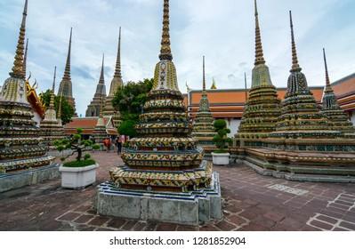 BANGKOK, THAILAND - JUNE 30, 2016 - Numerous chedis, or stupas, at the historic Wat Pho grounds in Bangkok, Thailand