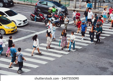 Bangkok, Thailand - June 30, 2019 : Crowds of people walk across the intersection at Asoke junction downtown of Bangkok, Thailand - Vintage filter