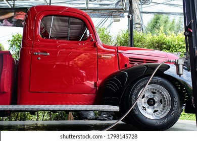 BANGKOK, THAILAND - JUNE 30, 2019: Classic Dodge pickups truck with red & black paint. The trucks known as Dodge Job-Rated trucks. Design with Art Deco styled front sheetmetal. Vintage car background.