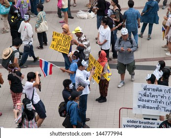 BANGKOK, THAILAND -JUNE 30 - Anti-government protesters wearing masks in Bangkok's shopping district The protesters are calling for the government to be overthrown June 30, 2013 in Bangkok, Thailand