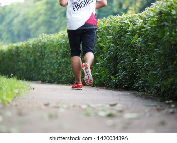 BANGKOK, THAILAND - JUNE 5, 2019 : People running in public park in the morning for good health, Healthy lifestyle concept.