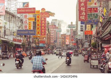 Bangkok, Thailand - June 5, 2019: the main street of Chinatown, Yaowarat Road in the evening, with its large signboards written in Chinese. Chinatown is one of the top tourist attractions of Bangkok.