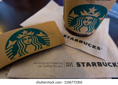 BANGKOK, THAILAND - JUNE 6, 2018: The Starbucks paper logo and napkin. Starbucks  is the biggest American coffee cafe establish since 1971 at Seattle Washington DC which is famous in the world.