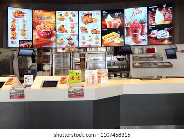 Bangkok, Thailand - June 6,2018: KFC drive thru on Ramintra Rd., Opposite Synphaet Hospital. KFC is a fast food restaurant chain that specializes in fried chicken.