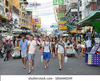 Bangkok, Thailand - June 7, 2012: Tourists walk along backpacker haven Khao San Road. Famous for its nightlife and market, budget accommodation in the Khao San area starts from $6 or B200 per night.