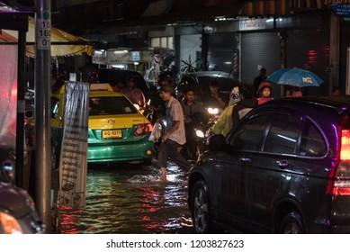 Bangkok, Thailand - June 7, 2017 : Water flood in Bangkok city problem with the manhole overflow in drainage system it full from garbage when rain storm.