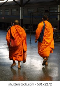BANGKOK, THAILAND - JUNE 7: Thai Buddhist monks walk through Bangkok's Hua Lamphong train station June 7, 2010 in Bangkok. There are an estimated 460,000 ordained monks in the Kingdom of Thailand.