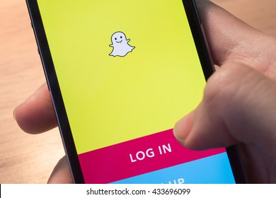 Bangkok, Thailand - June 8, 2016 : Apple iPhone5s held in one hand showing its screen with Snapchat application.