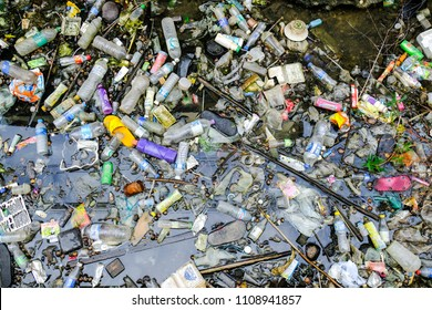 BANGKOK, THAILAND - JUNE 8, 2018: Plastic degradation is Problem of metropolis, Dirty canal with plastic bottle and other garbage  are cause of flooding.