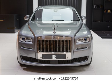 Bangkok, Thailand - June 8, 2019: a silver Rolls-Royce Ghost Series II in the exclusive showcase of Rolls-Royce Motor Cars Bangkok at Iconsiam Shopping Mall. The specified price is 31.9 million bahts.