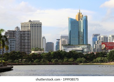 BANGKOK, THAILAND - JUNE 8: View across Benjakiti lake to Terminal 21 on June 8th 2014. This mall , opened in October 2011, has the longest escalators in Thailand, up to 36 metres.
