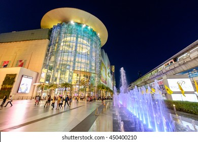 Bangkok, Thailand - June 9, 2016: Shoppers visit Siam Paragon mall in Siam Square mall on in Bangkok, Thailand. With 300,000 m 2 of retail space Siam Paragon is one of the largest malls in the world.