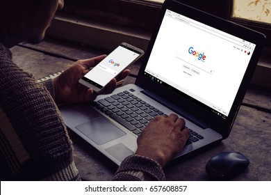 Bangkok. Thailand. June 9, 2017 : A man is typing on Google search engine from a laptop. Google is the biggest Internet search engine in the world.