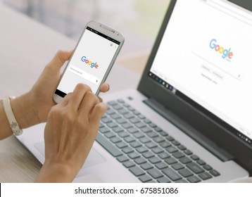Bangkok. Thailand. June 9, 2017 : A woman is typing on Google search engine from a laptop. Google is the biggest Internet search engine in the world.